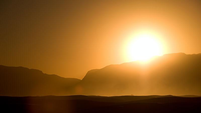 Sun-over-hill.jpg